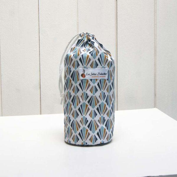pochon et ses 20 disques à démaquiller lavables bleu multicolore motif géométrique